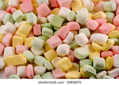 A pastel bed of dinner mints make up this tasty looking background.