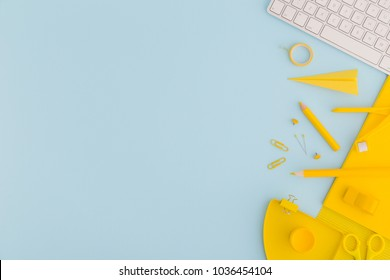 foto stock de blue background yellow school supplies back editar
