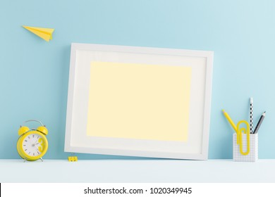 Pastel blue desk, table of young student with empty photo or poster frame, yellow supples, books and flying paper plane. Back to school cute mock up arrangement.