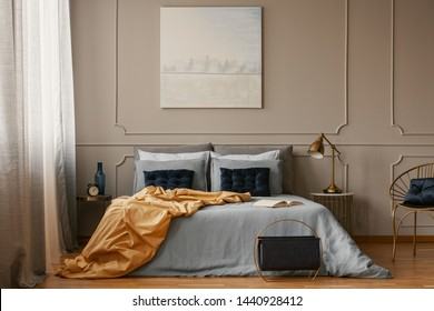 Pastel blue painting on grey wall of trendy bedroom interior
