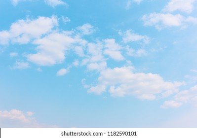 Pastel blue sky with white clouds - background with space for your own text