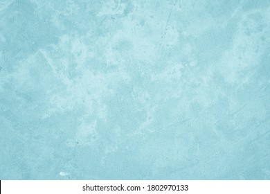 Pastel Blue and White concrete stone texture for background in summer wallpaper. Cement and sand wall of tone vintage. Concrete abstract wall of light cyan color, cement texture background for design.