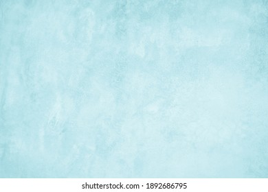 Pastel Blue and White concrete stone texture for background in summer wallpaper. Cement and sand wall of tone vintage. Concrete abstract wall of light cyan color, cement texture mint green for design.
