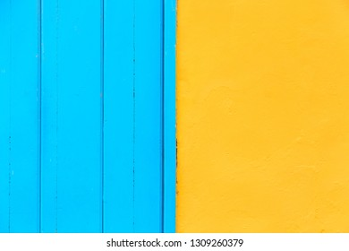 Pastel blue wooden and yellow wall background. Architecture details on Havana, Cuba
