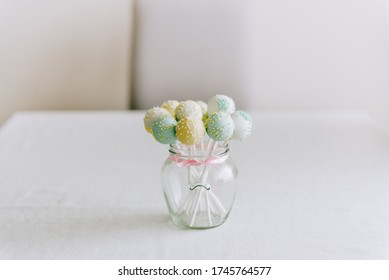 Pastel cake pops in a jar.