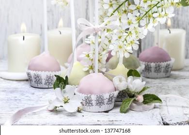 Pastel cake pops in romantic spring set. Popular american dessert.