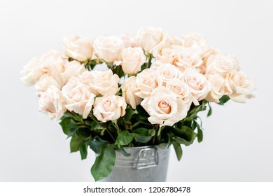 Pastel color. Beautiful light pink roses in bucket on street flower market. Rose flower holiday background.