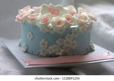 Pastel color cake with sugar art rose decoration