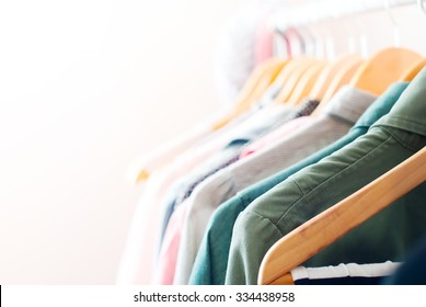 Pastel Color Clothes. Female Clothes on Open Clothes Rail