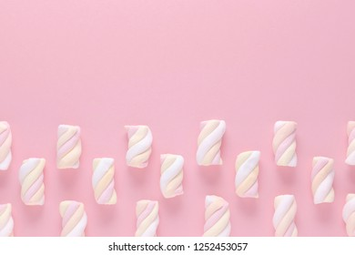 pastel color marshmallow on pink background with copy space