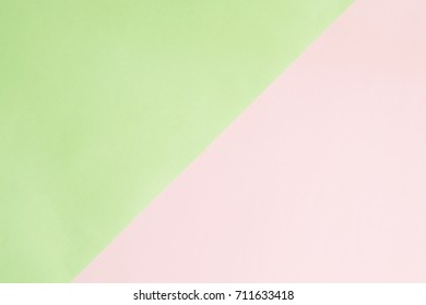 Pastel color paper background. Minimal background. Pink and green abstract pattern