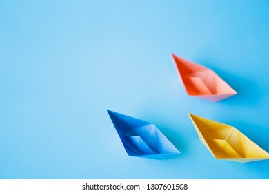 pastel color paper boat on clean background with copy space, learning and education concept
