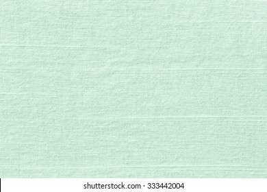 Pastel color of sea concept: Light grayish lime green fabric wallpaper texture background.