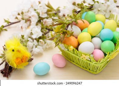 Pastel colored candies for Easter day  on wooden  table.