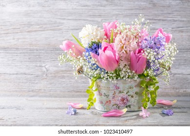 Pastel colored flowers in a vase