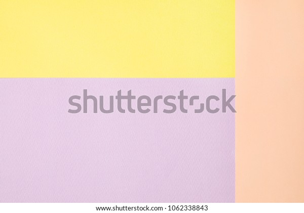 pastel colored paper background.