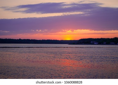 A pastel colored sunset over the Shark River in Belmar New Jersey.