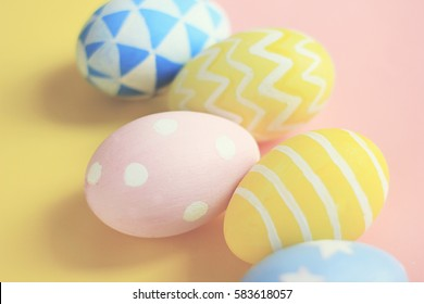 Pastel and colorful cute easter eggs with on colorful background