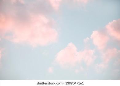 Pastel colors cumulus clouds background