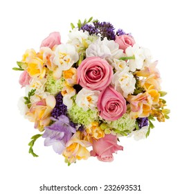 Pastel colors wedding bouquet made of Roses, Freesia, Carnation and Limonium flowers seen from above.
