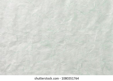 Pastel craft green white mulberry flower rough paper with stripe paper textured abstract background.