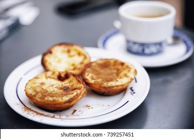 Pastel de nata and coffee at Pasteis de Belem cafe in Lisbon, Portugal