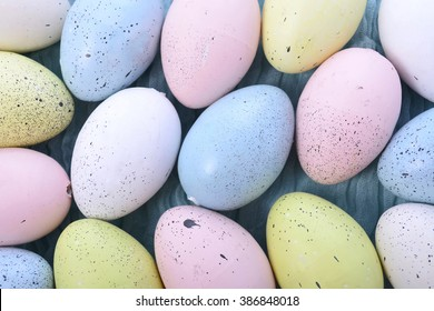 Pastel Easter Eggs on pale blue cheesecloth background.