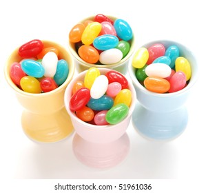 pastel eggcups filled with jellybeans for Easter
