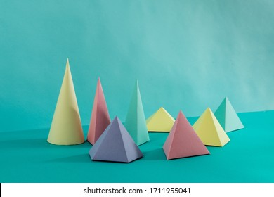 Pastel geometric figures, Paper craft. On light blue background.