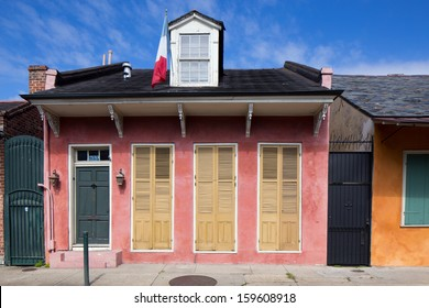 Pastel House with Shutters in French Quarter District of New Orleans, Louisiana