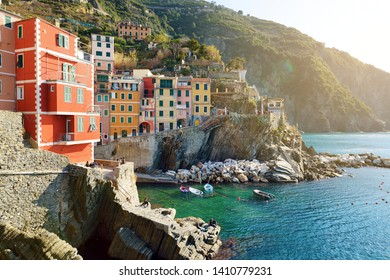 Pastel houses and tiny marina of Riomaggiore, the largest of the five centuries-old villages of Cinque Terre, located on rugged northwest coast of Italian Riviera, Liguria, Italy.