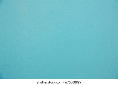 pastel mint color cement wall texture for background.blue wall background.turquoise painted wall background.Aquamarine background. Mint color