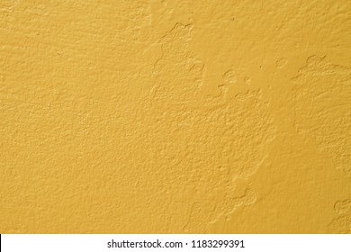 Pastel mustard yellow color concrete wall texture background.