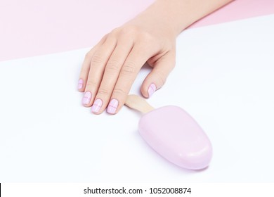 Pastel Nails. Hand With Fashion Nails Holding Ice Cream On Light Background. Close Up Of Female Hands With White Nails Holding Ice Cream. Art Nail Design. High Quality Image.