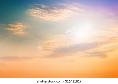 Pastel natural abstract blurred sky background create light soft colors and bright sunshine a short time before sunset.
