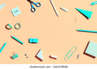 Pastel orange background and school supplies. Back to school. Flat lay.