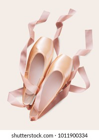 Pastel pink ballet shoes background. New pointe shoes with satin ribbon lay on white isolated backdrop