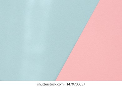 Pastel pink blue color paper background. Geometric figures, shapes. Diagonal joint. Abstract geometric flat composition. Empty space on monochrome cardboard