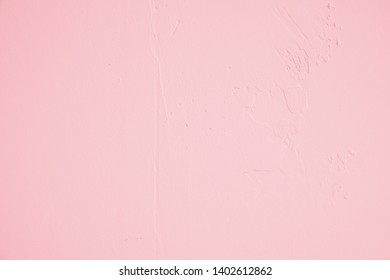 Pastel pink with randomly shaped structures and light soiling in industrial design. Pastel colored stone wall as a background and design element for art. Bright dark gradients.