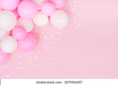 Pastel Pink Table With Colorful Balloons And Confetti For Birthday Top View Flat Lay Style