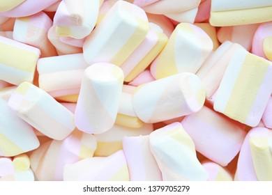 Pastel pink, yellow marshmallows background