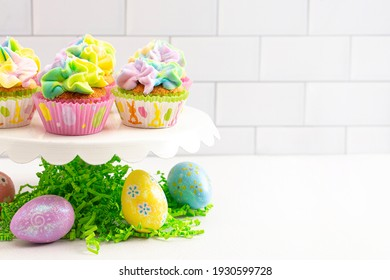 Pastel Rainbow Frosted Easter Cupcakes  on a White Kitchen Counter