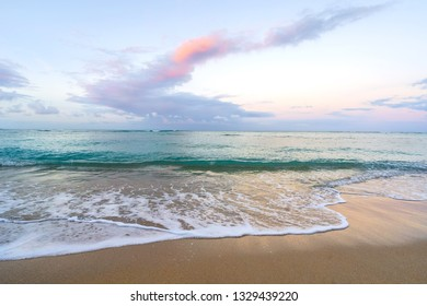 Pastel Sunrise of Waikiki beach, Hawaii. Beautiful pink and turquoise colors.