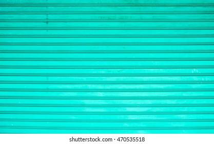 pastel tone steel door. Metal sheet fence texture background.
