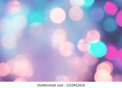 Pastel toned abstract background. Blurred lights. Bokeh effect. Yellow, pink, purple and cyan colors