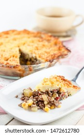 Pastel Tutup or shepherds pie Indonesian Style. Vegetables and meat or chicken covered with mashed potato, topped with grated cheddar cheese and baked. Dutch influence savory dish.