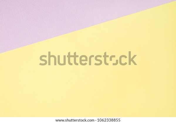 pastel violet and yellow papers background.