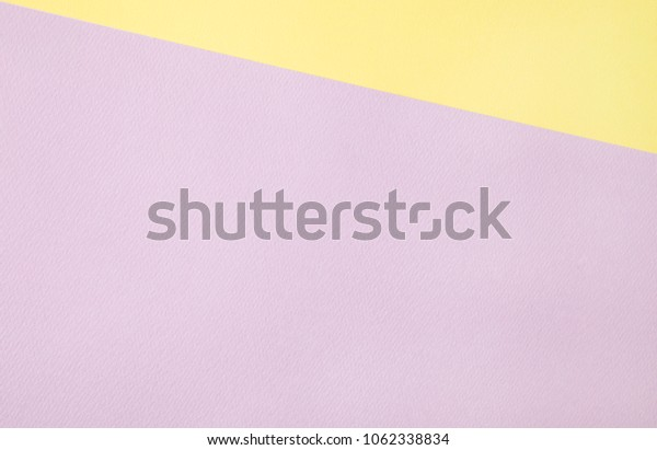 pastel yellow and lavender papers background.
