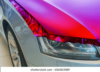 pasting of car carbonic plastic closeup