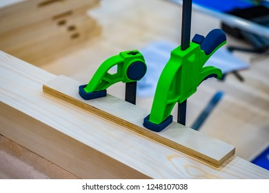 Pasting of two wooden surfaces. Carpentry. Joinery clamps. Work with the tree. A carpenter. Joiner.
